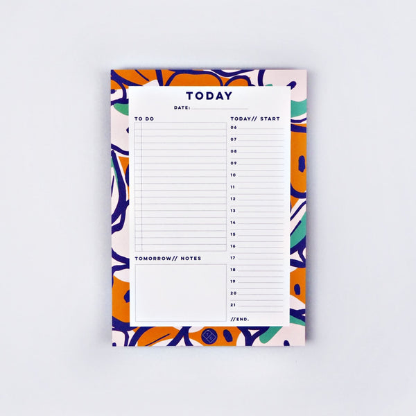 Daily planner note pad with sections to plan out your day.