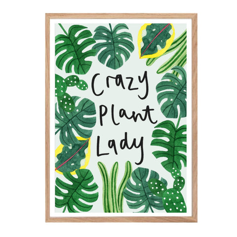 Print with the text 'crazy plant lady' surrounded by tropical leaves on a pale blue background.