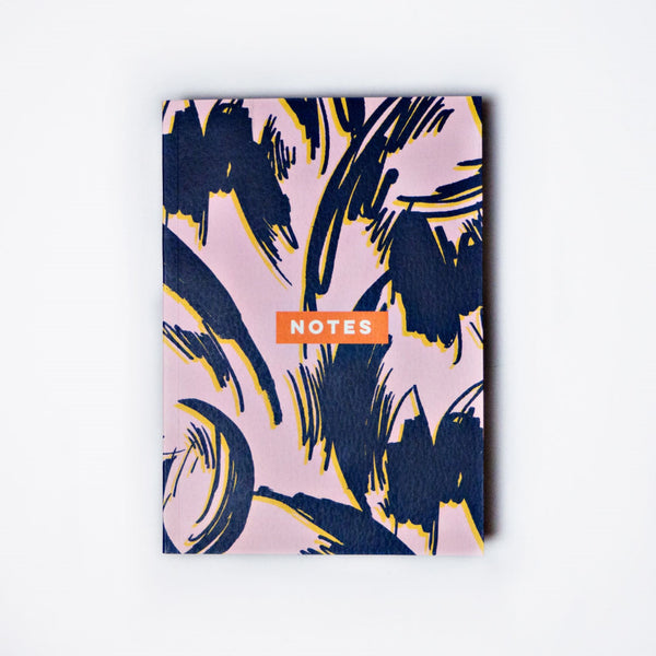 Lilac and navy floral design on cover of 144 paged notebook.