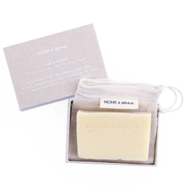 Soap containing natural ingredients that comes in a cotton bag and cardboard box.