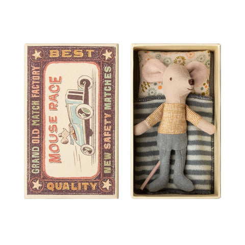 Little mouse in matchbox with bedding
