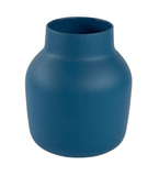 This vase is blue and has an organic shape. Its narrow at the top of the vase.
