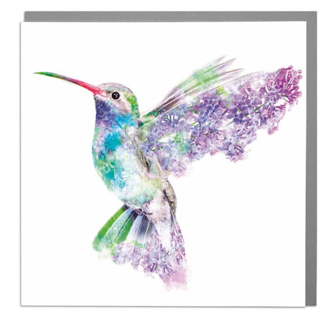 Beautiful Hummingbird in flight with its wings back and covered in flowers>