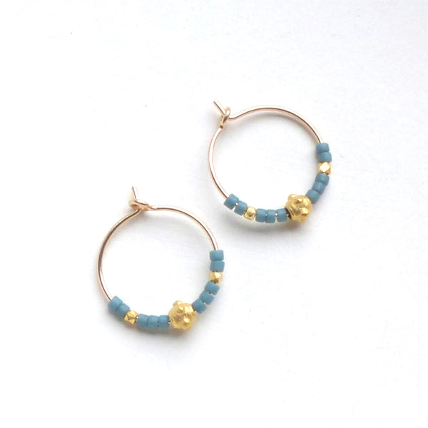 Gold hoop earrings with gold and sea blue beads