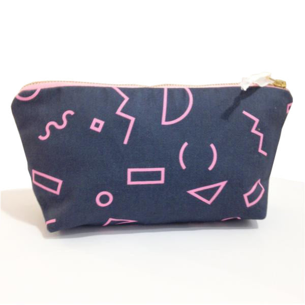 Zip case with a teal blue background and pink shapes.