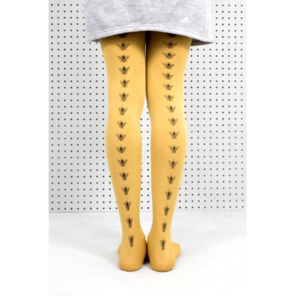 Mustard yellow tights with a black bee motif running down the back of both legs