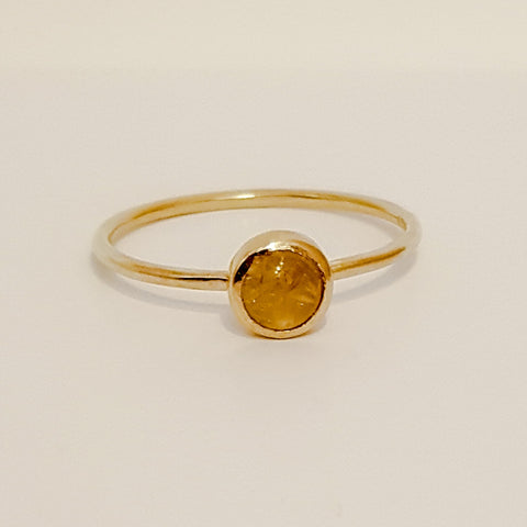 The rutilated quartz is orangeish in colour with what looks like 'naturally occurring gold strands like threads going through the quartz stone.
