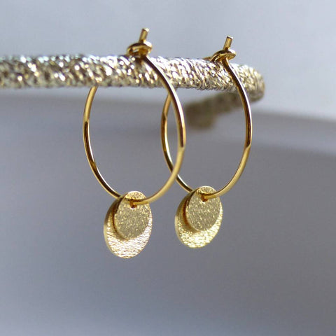 Double disc gold hoop earrings