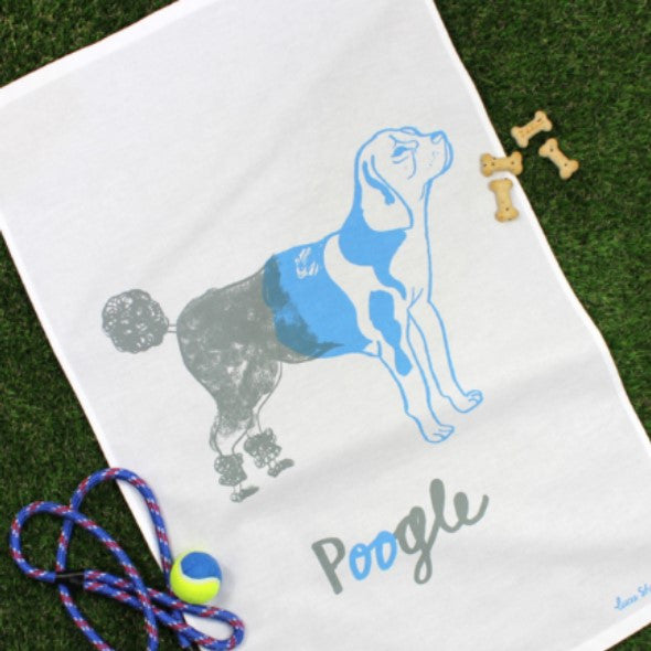 This hybrid hound screen printed tea towel features a dog that's half poodle in grey and half beagle in pale blue.