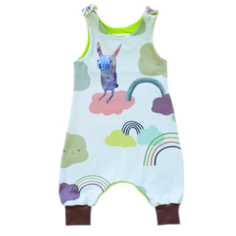 Organic cotton romper with rabbit, rainbow and cloud design on a pale blue background.