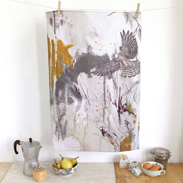 Cotton tea towel with an illustration of a red footed falcon.