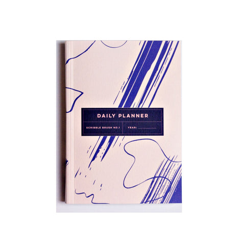 Daily planner note book with a cream and cobalt blue brushstroke design cover.