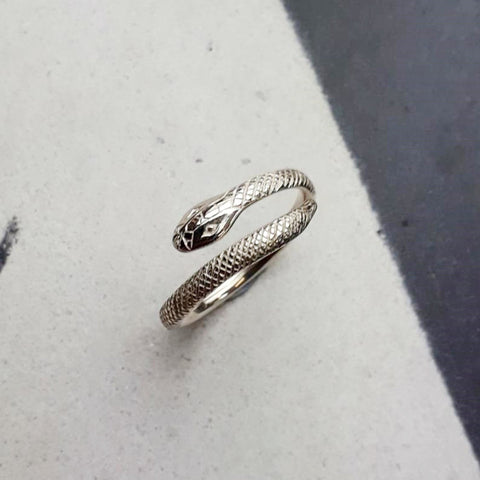 Adjustable silver snake ring.