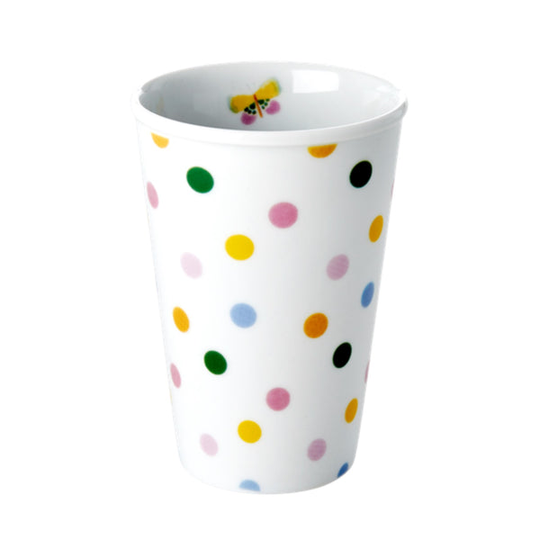 Porcelain cup with polka dot design and butterfly on the inside.