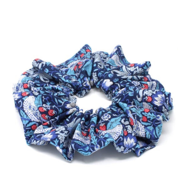 Liberty print cotton hair scrunchie with a blue bird and berry design.