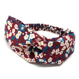 Liberty print cotton hairband with elasticated back.