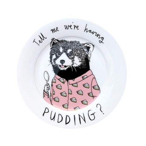Bone china plate with raccoon illustration.