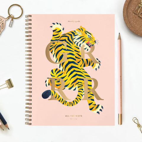 Eighteen month planner featuring a brightly striped tiger on the front over laid with the text GRRR in gold foil.