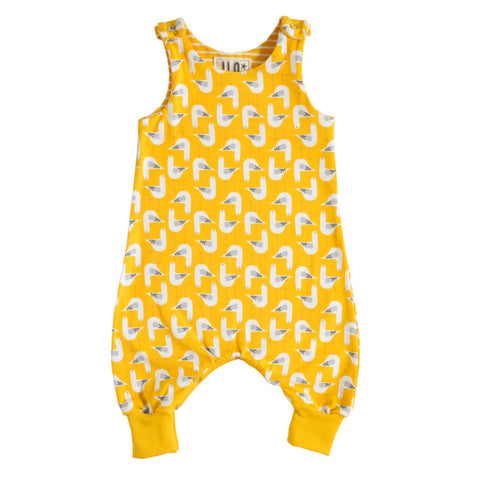 Organic cotton babygrow with seagull design on a yellow background.