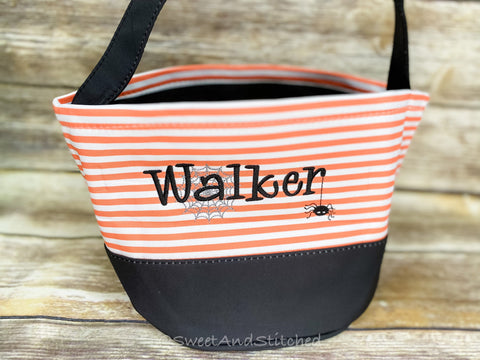 Monogrammed Halloween buckets in black and orange stripe, with name and spider web design