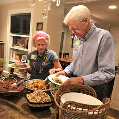 Ann Crile Esselstyn with Dr. Caldwell Esselstyn Jr. helping themselves to Fred and Rickys Mediterranean Protein Salad