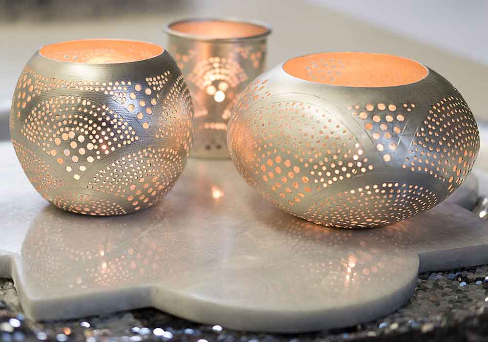 Zenza silver candle holders available at Pomegranate Living
