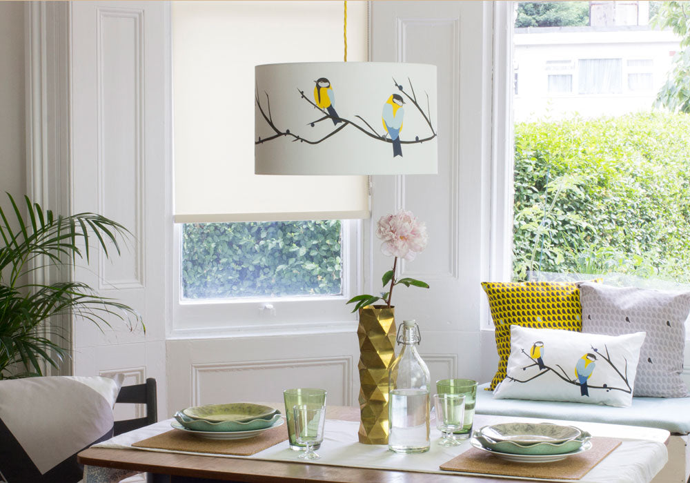 The lovely Juneberry & Bird lampshade by Lorna Syson in a living room situation, and available at Pomegranate Living