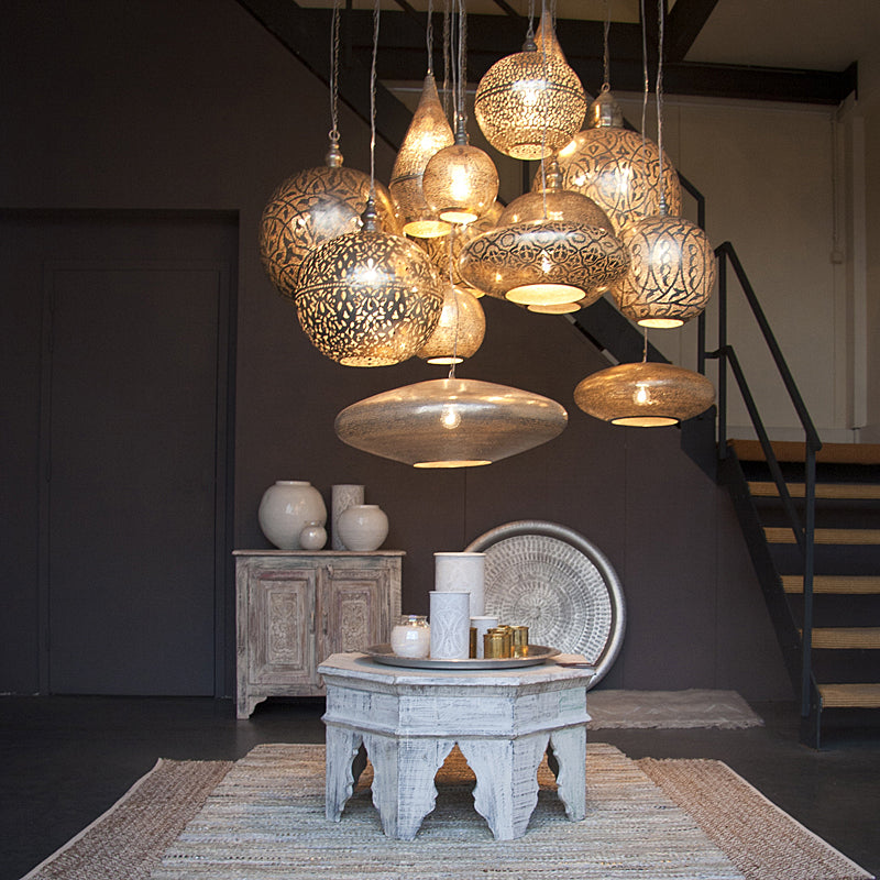 A dramatic display of several Zenza pendant lights