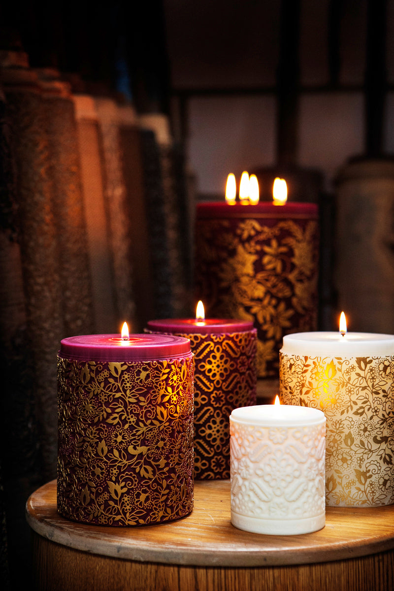 Beautiful lit candles made by Parable Designs