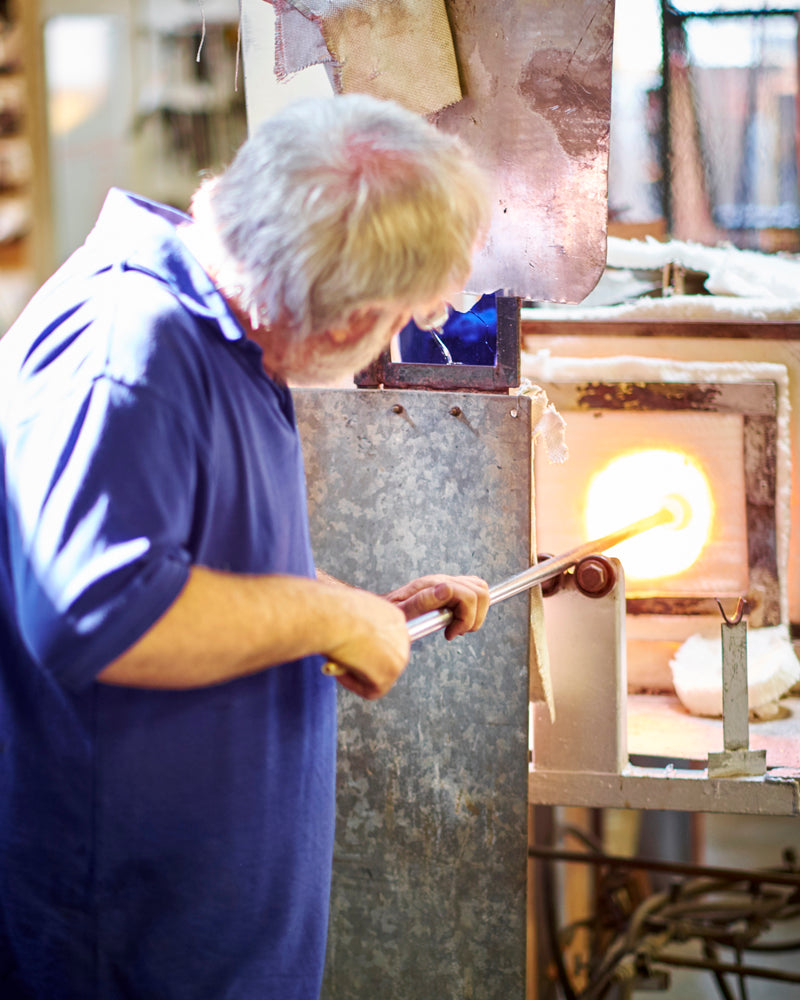 Heating up the molten glass in the oven