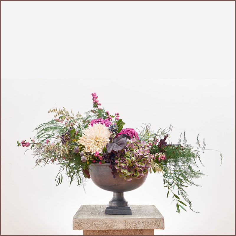 Wild Floral Display in Urn by The Velvet Daisy