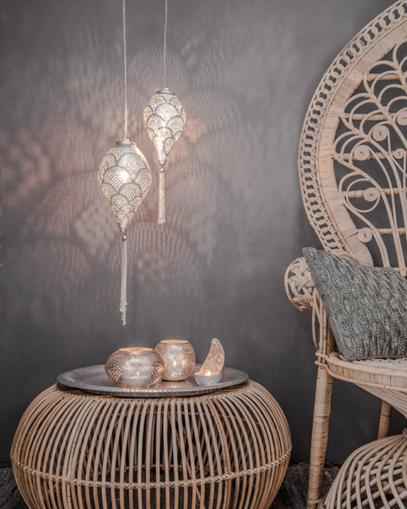 The charming Boho Fan small and large pendant lights hanging low over a side table