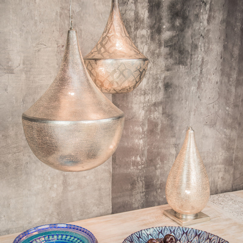 Zenza lights hanging over a table with blue bowls