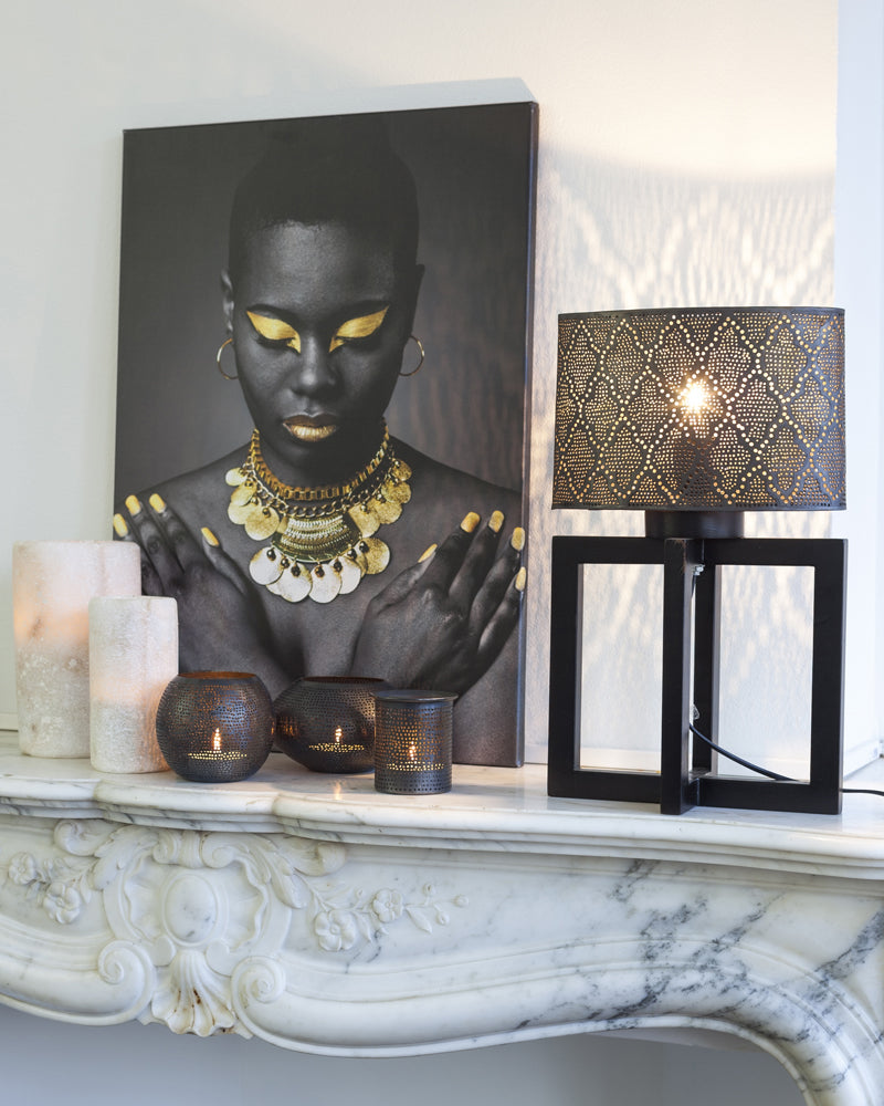 A Zenza table lamp displayed on a fireplace