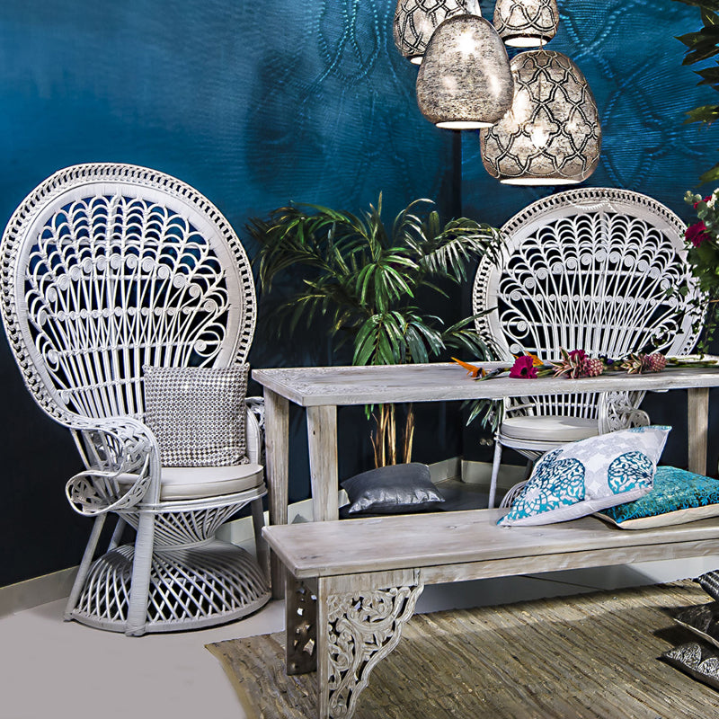 A giant rattan chair, whitewashed table and bench and pendant lights by Zenza