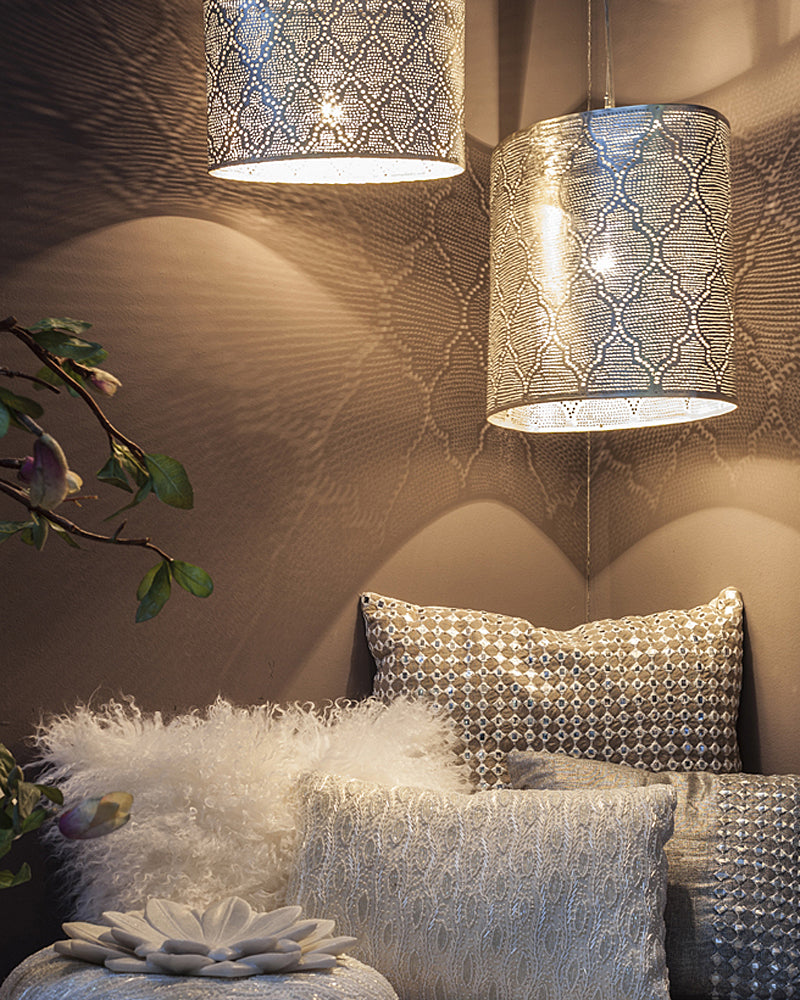 Zenza cushions beautifully displayed under an assortment of their pendant lights