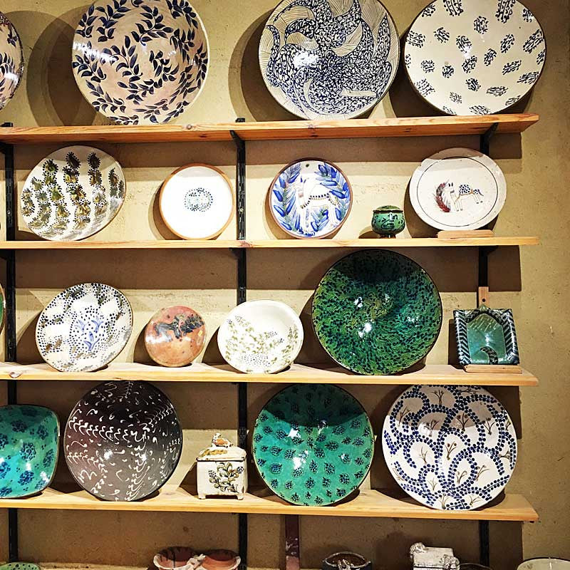 my-visit-to-the-charming-fayoum-pottery-school-pomegranate-blog-platters-on-shelves