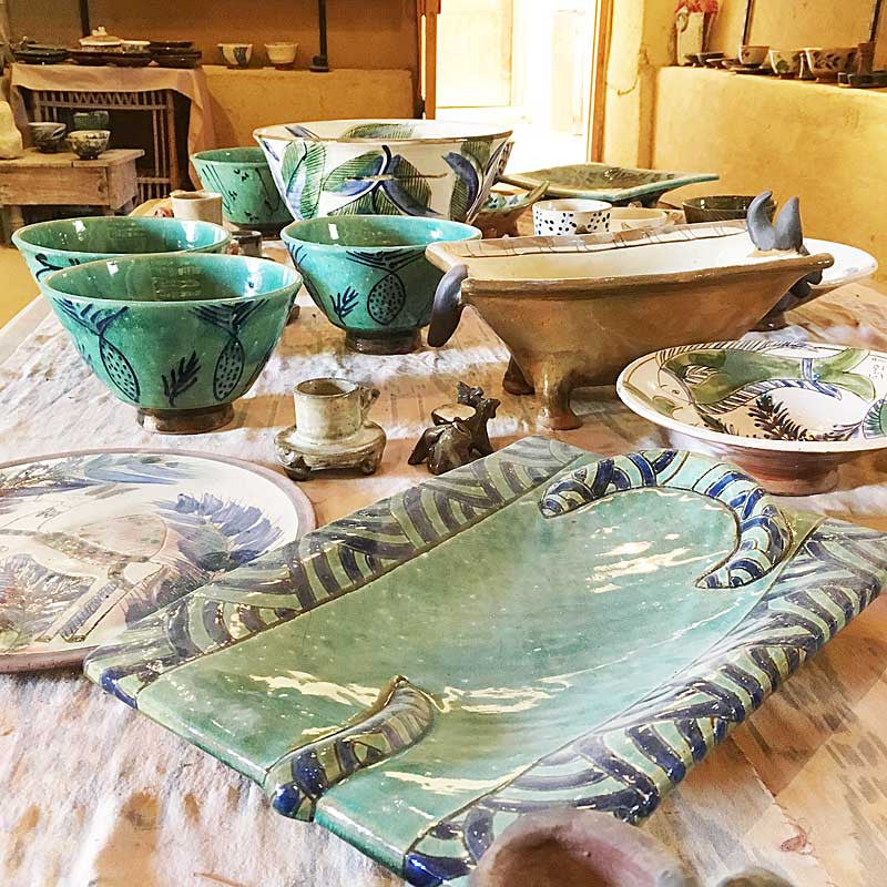 my-visit-to-the-charming-fayoum-pottery-school-pomegranate-blog-shop-platters-on-table