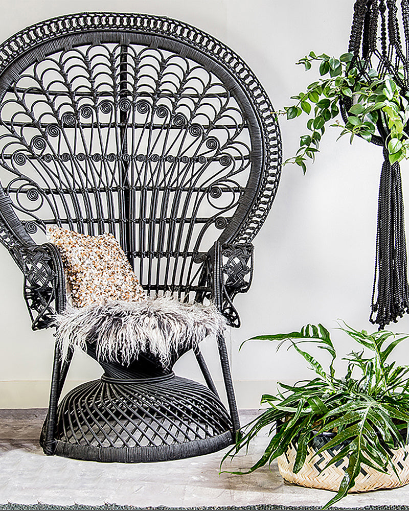 A large rattan chair in black looks pretty dramatic here