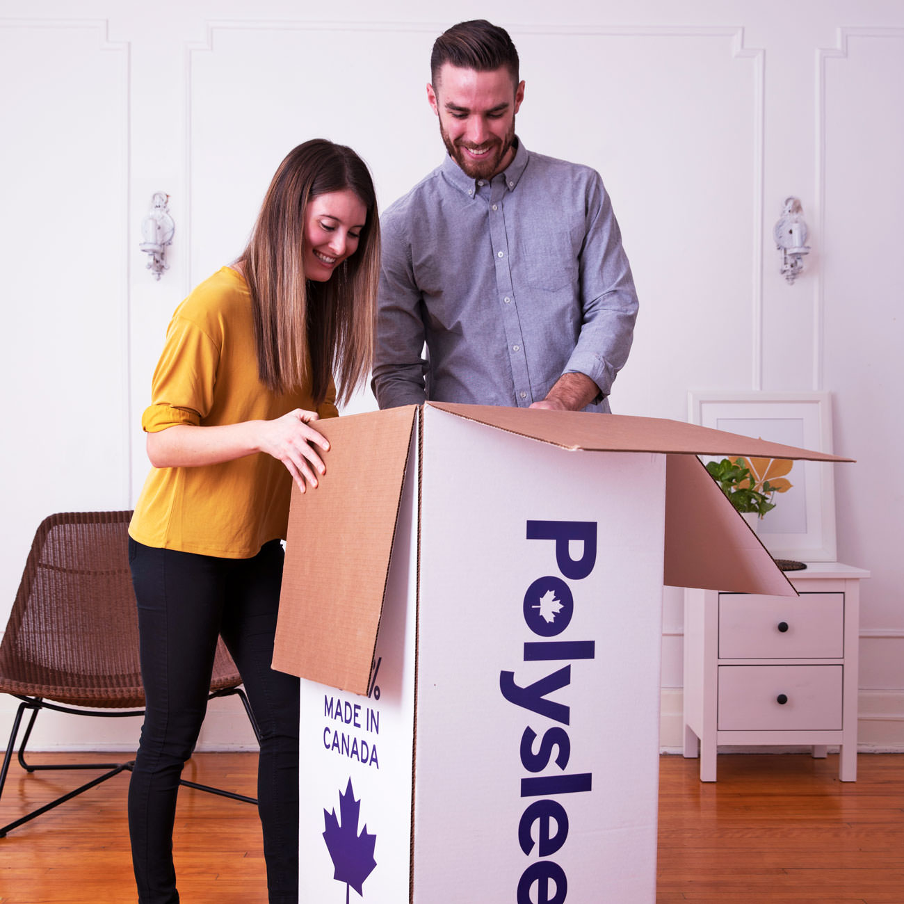 A couple opening their Polysleep mattress box