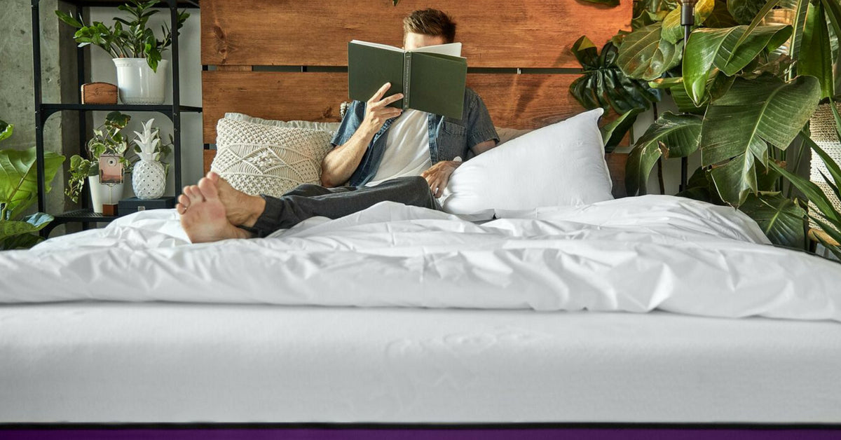 man reading his book on the Polysleep mattress