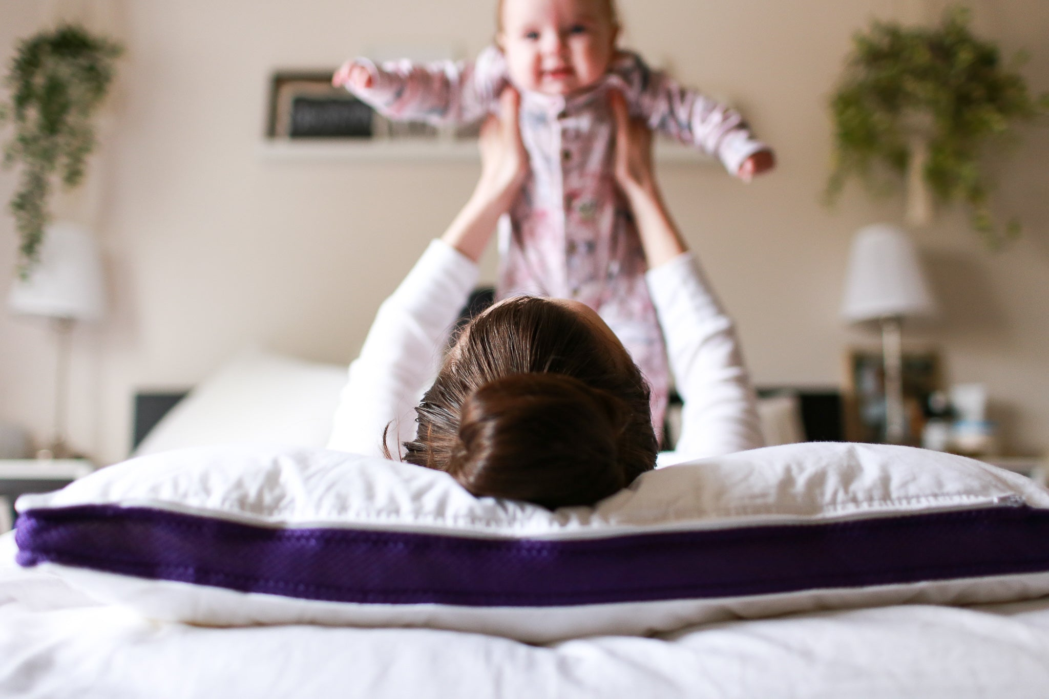 Mom and her baby having fun on a Polysleep Mattress.