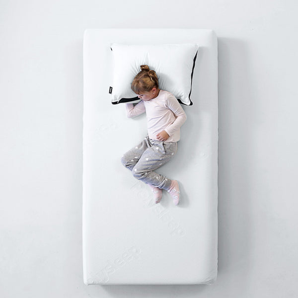 Little girl half asleep on the Polysleep mattress