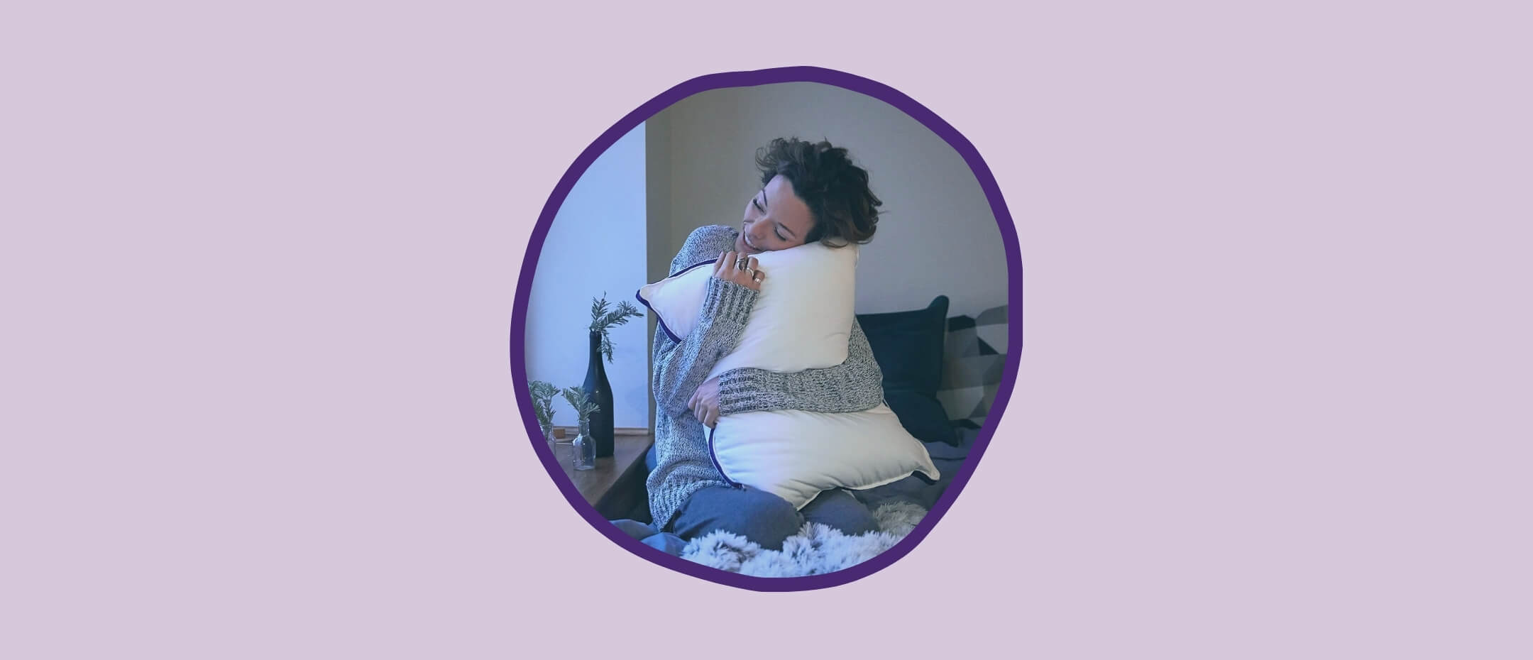 A woman hugging her Polysleep pillow very tight