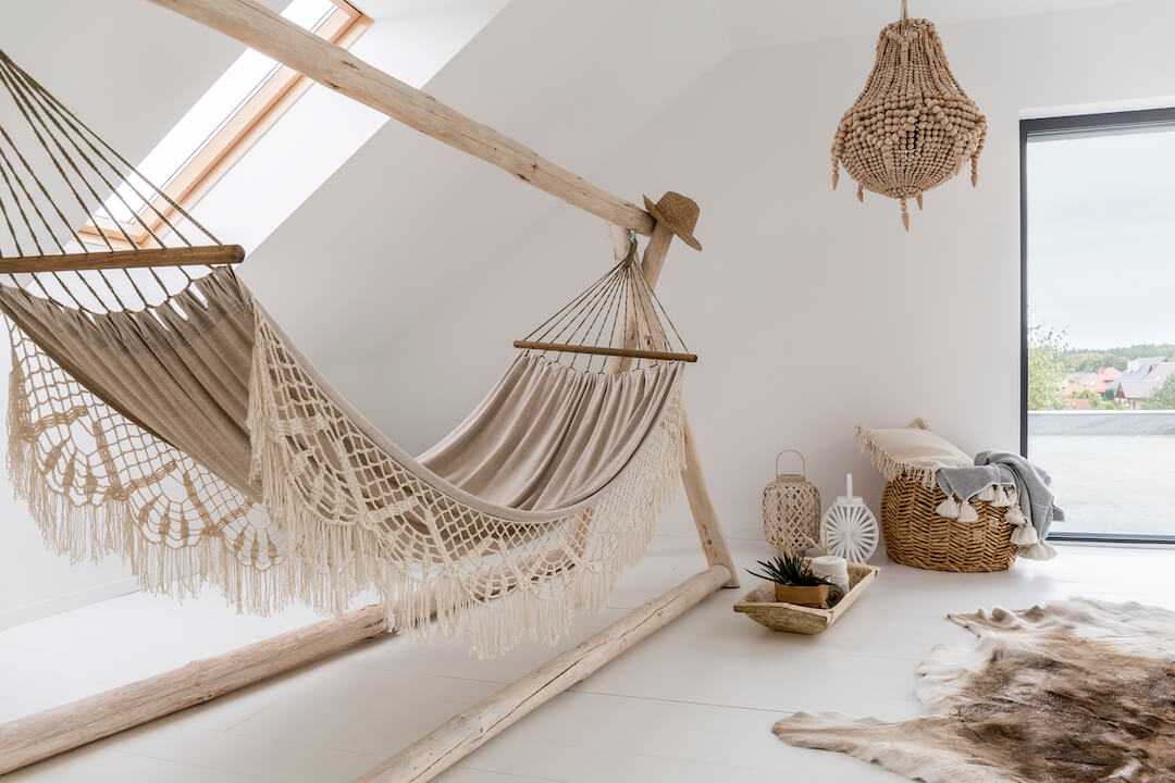 A hammock made of rope installed in a room