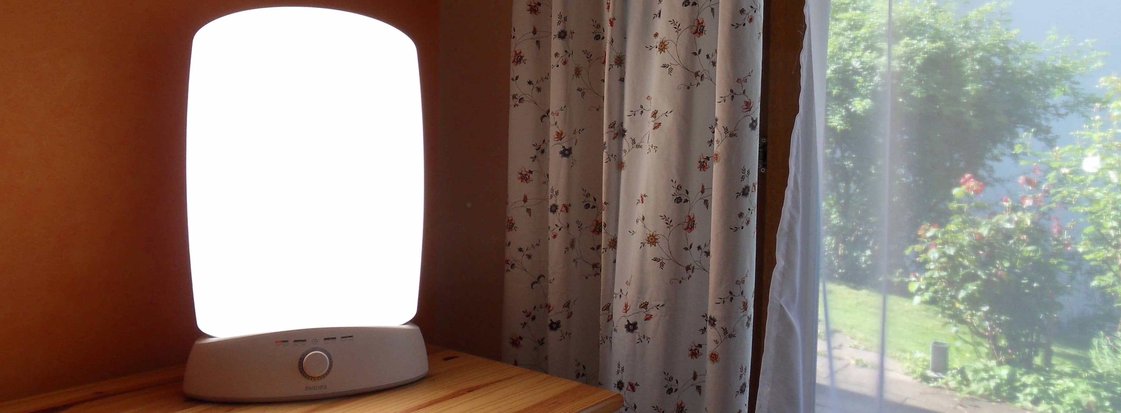 Light therapy lamp on a nightstand