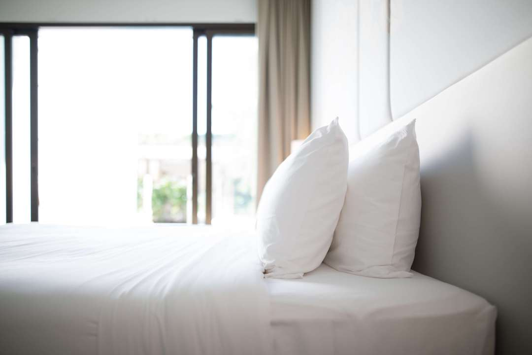 A clean bed with a good sheet