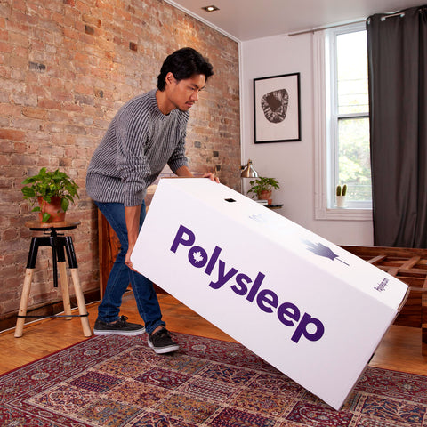 A client from Saskatoon is getting ready to unpack his new Polysleep mattress in his bedroom
