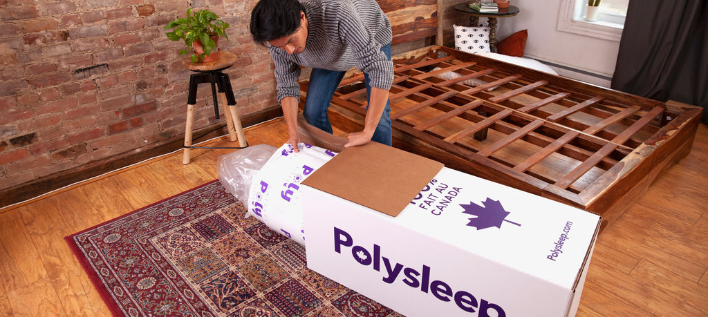 A compressed Polysleep mattress being taken out of its box