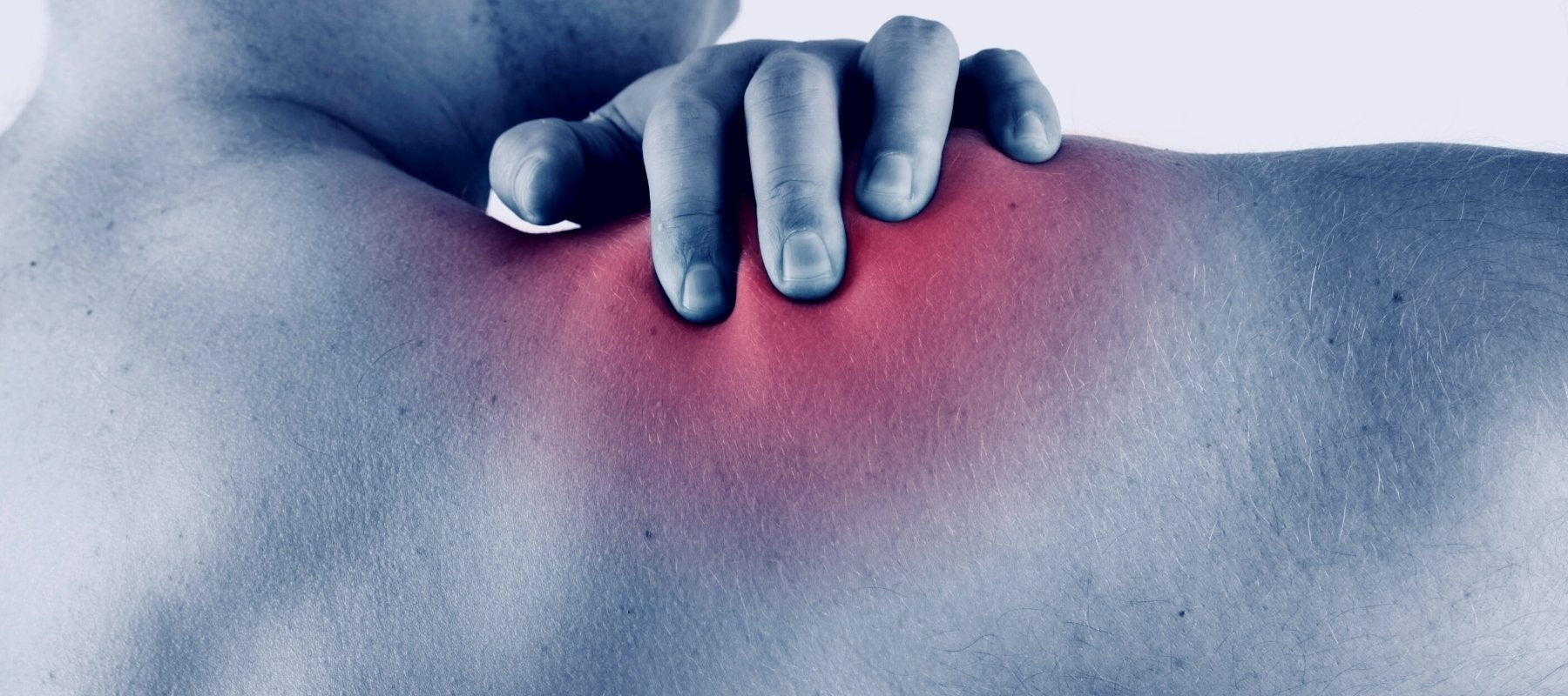 Close-up of a man touching his shoulder pain